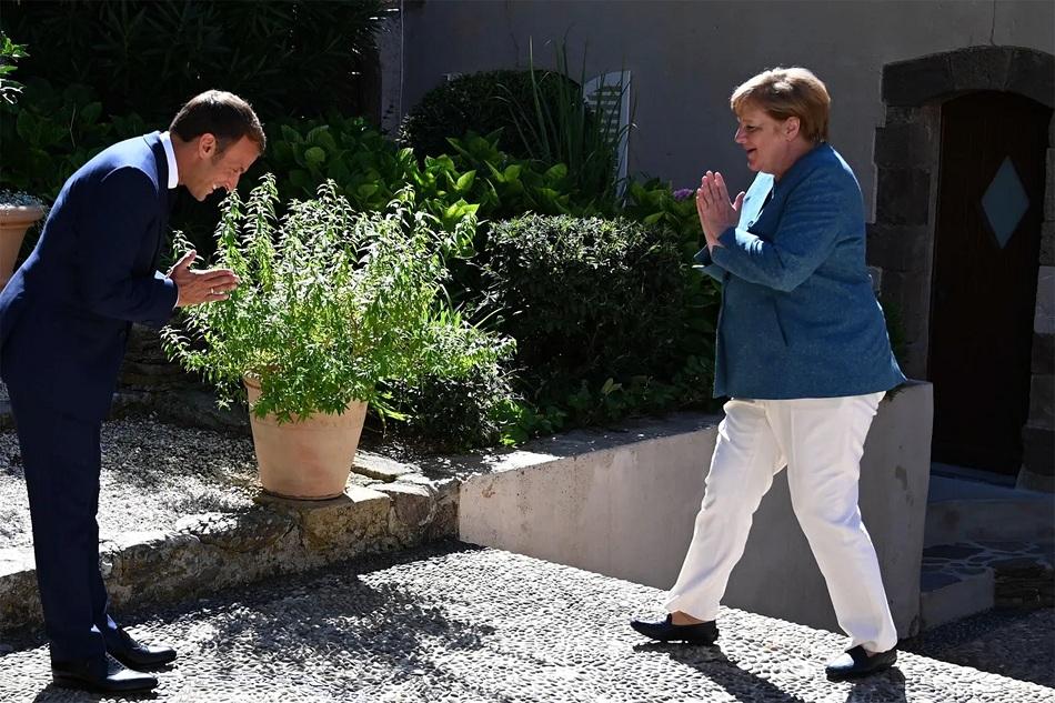 Макрон, Меркель нар гар ч барьсангүй. Шинэ хорио цээр тогтоогдохгүй л байвал бусад ёс жаяг ч хамаа алга.